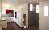 Celková rekonstrukce bytu se změnou dispozice v Praze v Modřanech o velikosti 3 + 1. Kuchyňská linka zhotovená na míru dle architektonického návrhu ve tvaru U. Pracovní plocha umístěna pod okny umožňuje dostatečné denní osvětlení a výhled z okna do zeleně. Materiál vysokotlatký laminát v bílém lesku doplňuje červený akcent uprostřed linky. Tato červená se objevuje naproti na výmalbě tmavěčervené zdi u jídelního stolu.Prostorná kuchyň skýtá jídelní kout s velkým obdélníkovým stolem, kde se vejde i osm hostů. Tři vestavěné skříně jsou rovněž vyrobeny dle přání klienta. Tyto skříně provzdušní prostor a pojmou spoustu věcí a také dolehčí úklid bytu. Doba realizace 7 týdnů.
